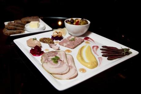 FOR G. Somerville, MA 2/6/2012 Charcuterie Platter - veal and pork campagne, porcelet coppa di testa, duck liver mousse, smoked beef heart, assorted pickles and sauces, bread, butter and olives. The backbar by journeyman is photographed in Union Square in Somerville, MA on Monday, February 6, 2012. (Yoon S. Byun/Globe Staff) Section: G Slug: 15cocktails Reporter: Devra First LOID: 5.0.826285213